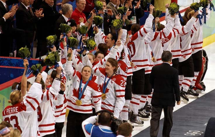 The Canadian Women's Team wave to the crowd after receiving their Gold Medals